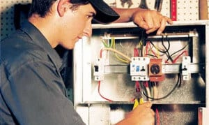 Gold Coast electrician inspecting a circuit
